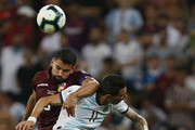 Angel Di Maria of Argentina jumps for a header with Tomas Rincon of Venezuela during the Copa America Brazil 2019 quarterfinal match between Argentina and Venezuela at Maracana Stadium on June 28, 2019 in Rio de Janeiro, Brazil.