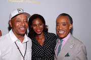 (L-R) Russell Simmons, Aisha McShaw, and the Rev. Al Sharpton attend the Argyleculture By Russell Simmons fashion show during Mercedes-Benz Fashion Week Spring 2015 at Helen Mills Event Space on September 5, 2014 in New York City.