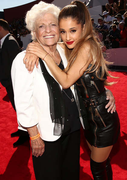 Ariana in black leather dress