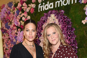 Ashley Graham and Amy Schumer  attend as Arianna Huffington and Chelsea Hirschhorn host Frida Mom Launch Dinner With Amy Schumer on July 30, 2019 in New York City.