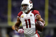 Larry Fitzgerald #11 of the Arizona Cardinals warms up on field before the game against the Minnesota Vikings at U.S. Bank Stadium on October 14, 2018 in Minneapolis, Minnesota.