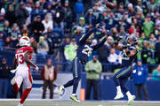 Cornerback Shaquill Griffin #26 of the Seattle Seahawks and Earl Thomas #29 prepare to intercept the ball from Quarterback Drew Stanton #5 of the Arizona Cardinals, but Griffin comes up with the ball in the third quarter at CenturyLink Field on December 31, 2017 in Seattle, Washington.