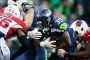 Running back Mike Davis #39 of the Seattle Seahawks is taken down by defensive lineman Olsen Pierre #72 of the Arizona Cardinals as he rushes in the first half at CenturyLink Field on December 31, 2017 in Seattle, Washington.