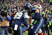 Tight end Jimmy Graham #88 of the Seattle Seahawks greets Doug Baldwin #89 after Baldwin pulled in a 29 yard touchdown against the Arizona Cardinals in the fourth quarter at CenturyLink Field on December 31, 2017 in Seattle, Washington.