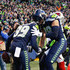 Jimmy Graham Photos - Tight end Jimmy Graham #88 of the Seattle Seahawks greets Doug Baldwin #89 after Baldwin pulled in a 29 yard touchdown against the Arizona Cardinals in the fourth quarter at CenturyLink Field on December 31, 2017 in Seattle, Washington. - Arizona Cardinals v Seattle Seahawks