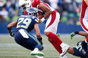 Tight end Jermaine Gresham #84 of the Arizona Cardinals tries to escape free safety Earl Thomas #29 of the Seattle Seahawks during the first half of the game at CenturyLink Field on December 31, 2017 in Seattle, Washington.