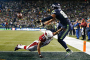 Tyrann Mathieu #32 of the Arizona Cardinals is called for defensive pass interference as he breaks up a pass intended for Jimmy Graham #88 of the Seattle Seahawks during the second quarter of their game at CenturyLink Field on November 15, 2015 in Seattle, Washington.