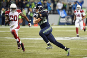 Jimmy Graham #88 of the Seattle Seahawks runs with the ball as Deone Bucannon #20 of the Arizona Cardinals defends during the third quarter at CenturyLink Field on November 15, 2015 in Seattle, Washington.