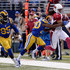 Larry Fitzgerald Photos - Larry Fitzgerald #11 of the Arizona Cardinals is run out of bounds by Lamarcus Joyner #20 of the St. Louis Rams in the second quarter at the Edward Jones Dome on December 6, 2015 in St. Louis, Missouri. - Arizona Cardinals v St Louis Rams