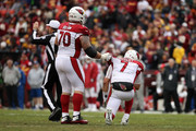 Offensive Guard Evan Boehm #70 helps quarterback Blaine Gabbert #7 of the Arizona Cardinals up after a play in the second quarter against the Washington Redskins at FedEx Field on December 17, 2017 in Landover, Maryland.