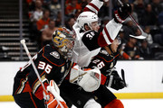 John Gibson #36 and Brandon Montour #26 of the Anaheim Ducks defend against Christian Fischer #36 of the Arizona Coyotes during the second period of a game at Honda Center on October 10, 2018 in Anaheim, California.