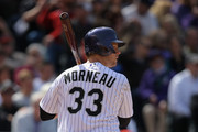 First baseman Justin Morneau #33 of the Colorado Rockies takes an at bat against the Arizona Diamondbacks during the home opener at Coors Field on April 4, 2014 in Denver, Colorado. The Rockies defeated the Diamondbacks 12-2.