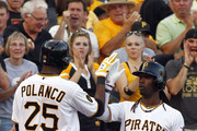 Gregory Polanco #25 of the Pittsburgh Pirates celebrates with Andrew McCutchen #22 after hitting a two run home run in the second inning against the Arizona Diamondbacks during the game at PNC Park on July 2, 2014 in Pittsburgh, Pennsylvania.