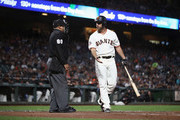 Madison Bumgarner #40 of the San Francisco Giants complains to home plate umpire Adrian Johnson #80 after he struck out in the third inning at AT&T Park on August 28, 2018 in San Francisco, California.