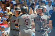 Alex Avila #5 of the Arizona Diamondbacks is congratulated by Zack Godley #52 (R) and Nick Ahmed #13 (L) after hitting a two-run home run against the Chicago Cubs during the fourth inning at Wrigley Field on July 26, 2018 in Chicago, Illinois.