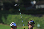Webb Simpson of the United States plays his tee shot at the par 4, 18th hole watched by his playing partner Bubba Watson of the United States during the second round of the 2013 Arnold Palmer Invitational Presented by Mastercard at Bay Hill Golf and Country Club on March 22, 2013 in Orlando, Florida.