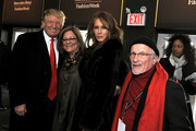 Donald Trump, Senior Vice President of IMG Fashion Fern Mallis, Melania Trump, and Stan Herman attend Mercedes-Benz Fashion Week at Bryant Park on February 17, 2010 in New York City.