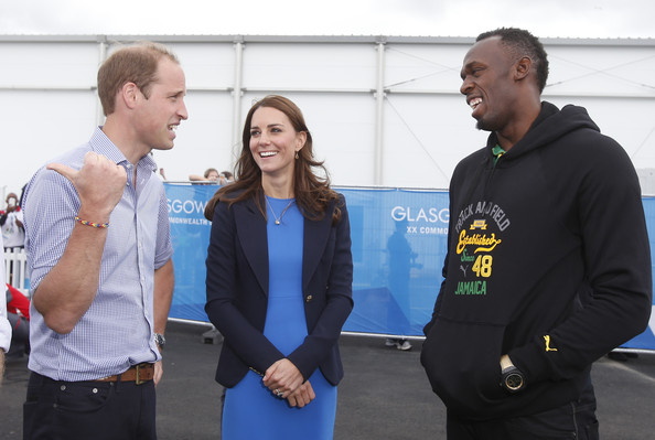 (L-R) Prince William, Duke of Cambridge and Catherine, Duchess of Cambridge meet Usain Bolt during a visit to the Commonwealth Games Village on July 29, 2014 in Glasgow, Scotland.