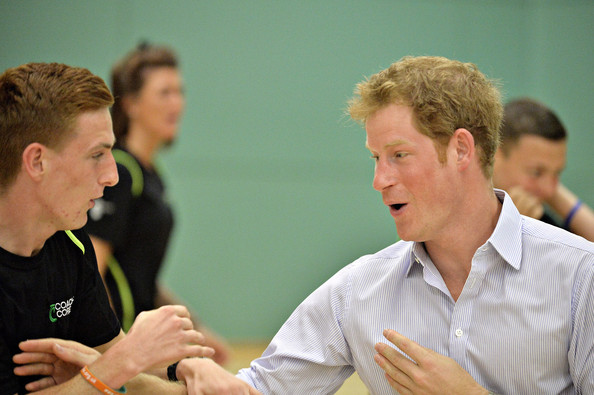 Prince Harry tries his hand at boxing as he and Prince William, Duke of Cambridge (not pictured) visit a Coach Core project at Gorbals Leisure Centre on July 29, 2014 in Glasgow, Scotland.