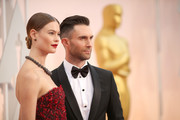 Recording artist Adam Levine (R) and Behati Prinsloo attend the 87th Annual Academy Awards at Hollywood & Highland Center on February 22, 2015 in Hollywood, California.