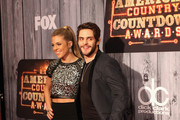 Lauren Gregory (L) and singer Thomas Rhett attend the 2014 American Country Countdown Awards at Music City Center on December 15, 2014 in Nashville, Tennessee.
