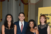 Actress Reshma Shetty, IRC President and CEO David Miliband, guest, and Louise Miliband attend the Annual Freedom Award Benefit hosted by the International Rescue Committee at the Waldorf-Astoria hotel on November 6, 2013 in New York City.