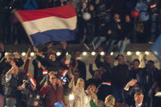 King Willem-Alexander and Queen Maxima of The Netherlands wave to the crowd from a boat after the Freedom Concert on May 5, 2014 in Amsterdam, Netherlands.