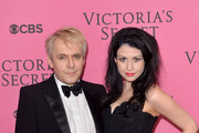Nick Rhodes and girlfriend Nefer Suvio attends the pink carpet of the 2014 Victoria's Secret Fashion Show on December 2, 2014 in London, England.