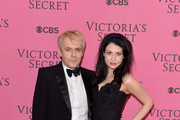 Nick Rhodes and girlfriend Nefer Suvio attend the pink carpet of the 2014 Victoria's Secret Fashion Show on December 2, 2014 in London, England.