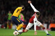 Antoine Griezmann of Atletico Madrid and Aaron Ramsey of Arsenal during the UEFA Europa League Semi Final leg one match between Arsenal FC and Atletico Madrid at Emirates Stadium on April 26, 2018 in London, United Kingdom.