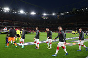 Aaron Ramsey of Arsenal looks over as the team walk onto the pitch before the UEFA Europa League quarter final leg one match between Arsenal FC and CSKA Moskva at Emirates Stadium on April 5, 2018 in London, United Kingdom.
