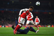 Hatem Ben Arfa of PSG (L) is fouled by Alex Oxlade-Chamberlain of Arsenal (R) during the UEFA Champions League Group A match between Arsenal FC and Paris Saint-Germain at the Emirates Stadium on November 23, 2016 in London, England.