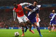 Danny Welbeck of Arsenal battles with Sacha Kljestan of Anderlecht during the UEFA Champions League Group D match between Arsenal FC and RSC Anderlecht at Emirates Stadium on November 4, 2014 in London, United Kingdom.
