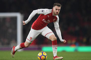 Aaron Ramsey of Arsenal runs with the ball during the Premier League match between Arsenal and Manchester City at Emirates Stadium on March 1, 2018 in London, England.