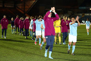 Jill Scott nad Demi Stokes of Manchester City Ladies lead the applause after losing the WSL Continental Cup Final between Arsenal Women and Manchester City Ladies at Adams Park on March 14, 2018 in High Wycombe, England.