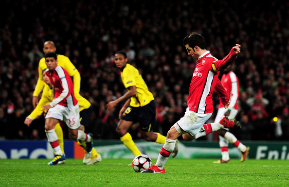 Cesc Fabregas Cesc Fabregas of Arsenal scores from the penalty spot to level the scores at 2-2 after being brought down by Carles Puyol of Barcelona during the UEFA Champions League quarter final first leg match between Arsenal and FC Barcelona at the Emirates Stadium on March 31, 2010 in London, England.