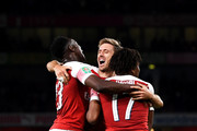 Danny Welbeck of Arsenal celebrates with teammates after he scores his sides second goal during the Carabao Cup Third Round match between Arsenal and Brentford at Emirates Stadium on September 26, 2018 in London, England.