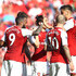 Jack Wilshere Granit Xhaka Photos - Alexandre Lacazette of Arsenal celebrates after scoring his sides second goal with his team mates during the Premier League match between Arsenal and Burnley at Emirates Stadium on May 6, 2018 in London, England. - Arsenal vs. Burnley - Premier League