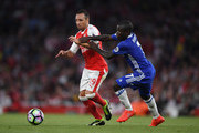 Santi Cazorla of Arsenal (L) takes it past N'Golo Kante of Chelsea (R) during the Premier League match between Arsenal and Chelsea at the Emirates Stadium on September 24, 2016 in London, England.