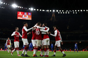 Aaron Ramsey of Arsenal celebrates after scoring his sides fifth goal and his hat-trick with his team mates during the Premier League match between Arsenal and Everton at Emirates Stadium on February 3, 2018 in London, England.