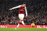 Aaron Ramsey of Arsenal scores his sides third goal  during the Premier League match between Arsenal and Everton at Emirates Stadium on February 3, 2018 in London, England.