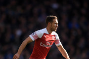 Aaron Ramsey of Arsenal runs with the ball during the Premier League match between Arsenal FC and Everton FC at Emirates Stadium on September 23, 2018 in London, United Kingdom.