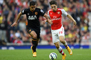 Hector Bellerin of Arsenal battles for the ball with Hatem Ben Arfa of Hull City during the Barclays Premier League match between Arsenal and Hull City at Emirates Stadium on October 18, 2014 in London, England.