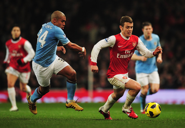 Jack Wilshere of Arsenal evades Nigel de Jong of Manchester City during the Barclays Premier League match between Arsenal and Manchester City at the Emirates Stadium on January 5, 2011 in London, England.