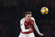 Aaron Ramsey of Arsenal heads the ball during the Premier League match between Arsenal and Manchester City at Emirates Stadium on March 1, 2018 in London, England.