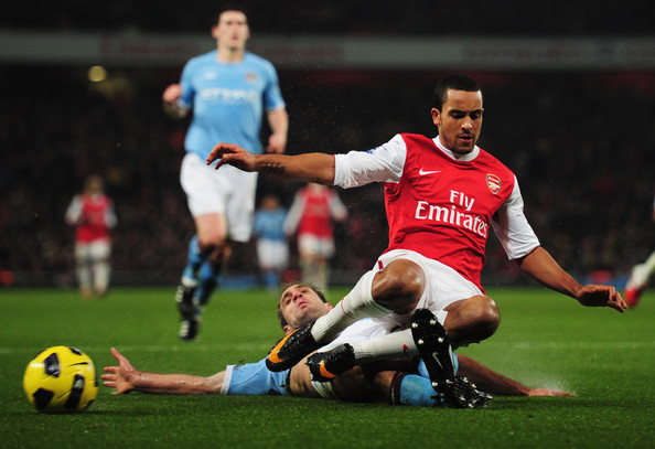 Theo Walcott of Arsenal is tackled by Pablo Zabaleta of Manchester City during the Barclays Premier League match between Arsenal and Manchester City at the Emirates Stadium on January 5, 2011 in London, England.