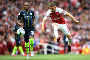 Aaron Ramsey of Arsenal shoots during the Premier League match between Arsenal FC and Manchester City at Emirates Stadium on August 12, 2018 in London, United Kingdom.