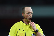 Referee Mike Dean looks on during the Barclays Premier League match between Arsenal and Manchester United at Emirates Stadium on November 22, 2014 in London, England.