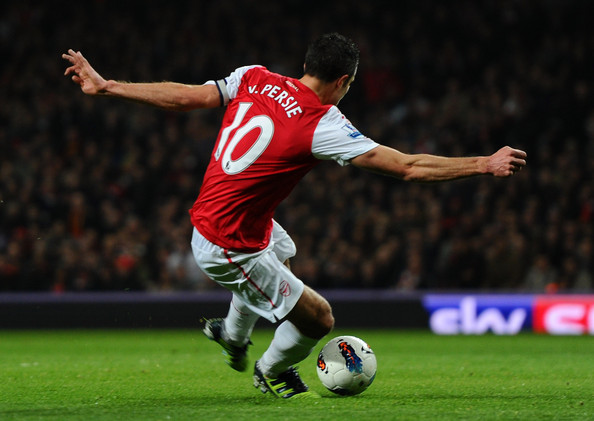 Robin van Persie of Arsenal scores their first goal during the Barclays Premier League match between Arsenal and Newcastle United at Emirates Stadium on March 12, 2012 in London, England.