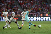 Aaron Ramsey (R) of Arsenal plays a pass while Christopher Nkunku of Paris Saint Germain gives chase during the International Champions Cup match between Arsenal and Paris Saint Germain at the National Stadium on July 28, 2018 in Singapore.